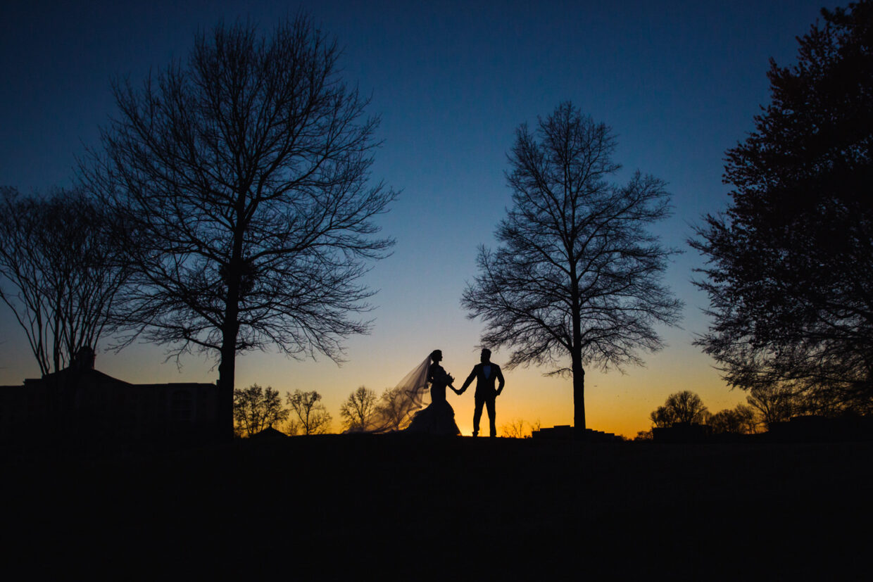 Beautiful couple watching the sunset at The Ballantyne Hotel