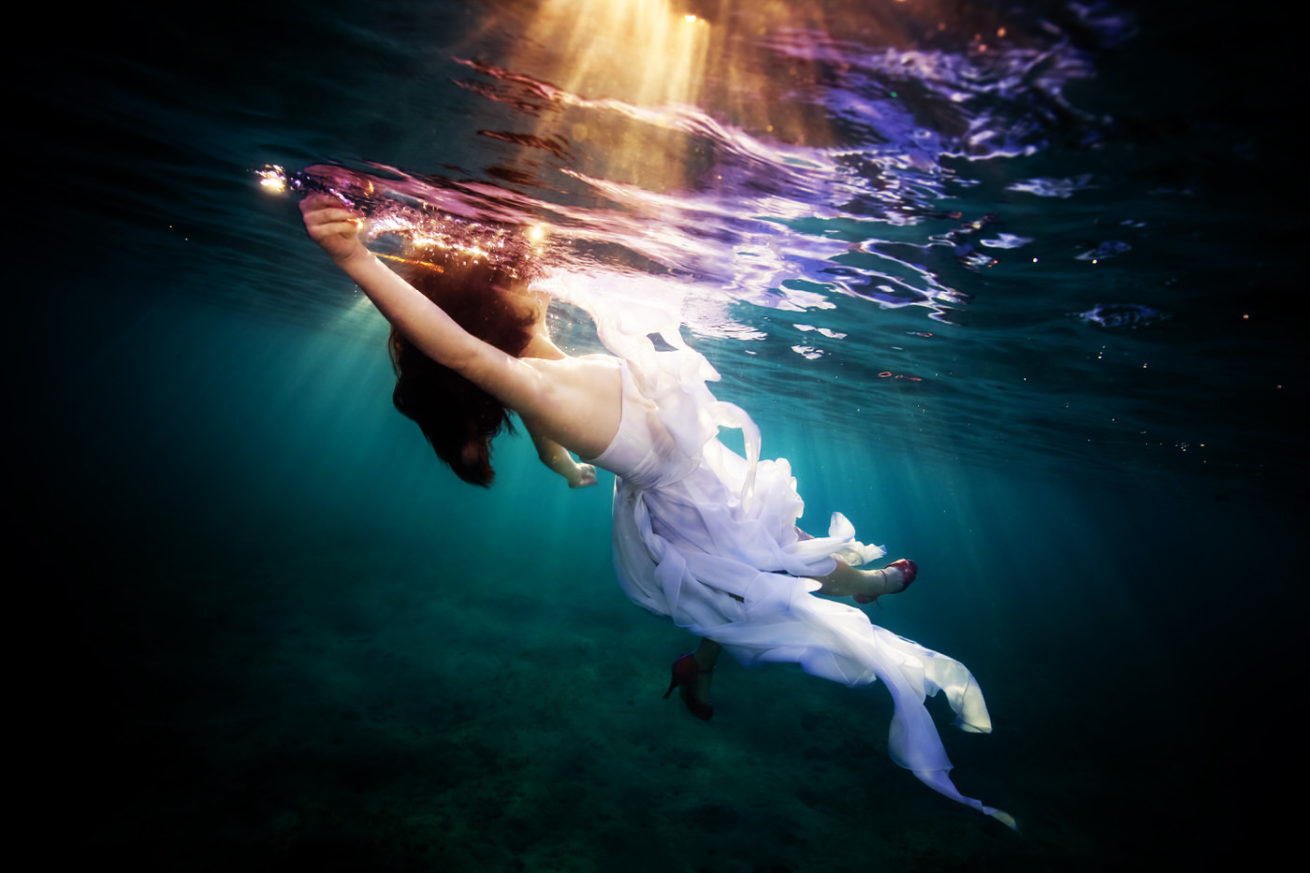 Trashing the dress, underwater session
